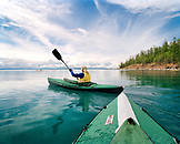 MONGOLIA, Lake Khuvsgul, the dark blue pearl, a woman kayaking, Khuvsgul National Park, rear view