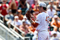 Texas Longhorns pitcher John Curtiss (43) looks to his catcher for the sign during the NCAA Super Regional baseball game against the Houston Cougars on June 7, 2014 at UFCU Disch–Falk Field in Austin, Texas. The Longhorns are headed to the College World Series after they defeated the Cougars 4-0 in Game 2 of the NCAA Super Regional. (Andrew Woolley/Four Seam Images)