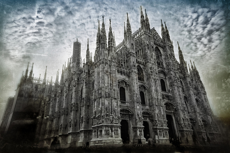 View on Milan Cathedral (IDuomo di Milano), the cathedral church of Milan, Italy. .The Gothic cathedral took nearly six centuries to complete. It is the fourth largest cathedral in the world and the largest in the Italian state territory.
