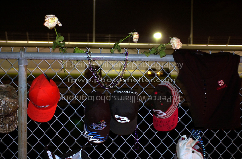 Hats and memrobilia hang on the fence near the location of Dale Earnhardt, Srs. fatal crash on the final lap of the Daytona 500  .18 Feb.2001  Daytona International Speedway  Daytona Beach, Florida, USA.Copyright©F.Peirce Williams 2001..F. Peirce Williams .photography.P.O.Box 455 Eaton, OH 45320.p: 317.358.7326  e: fpwp@mac.com.