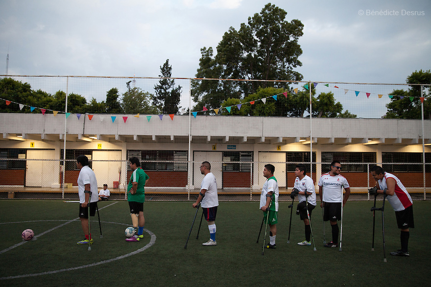 """Players from Guerreros Aztecas during a training session with the team in Mexico City, Mexico on June 12, 2014. Guerreros Aztecas (""""Aztec Warriors"""") is Mexico City's first amputee football team. Founded in July 2013 by five volunteers, they now have 23 players, seven of them have made the national team's shortlist to represent Mexico at this year's Amputee Soccer World Cup in Sinaloathis December.The team trains twice a week for weekend games with other teams. No prostheses are used, so field players missing a lower extremity can only play using crutches. Those missing an upper extremity play as goalkeepers. The teams play six per side with unlimited substitutions. Each half lasts 25 minutes. The causes of the amputations range from accidents to medical interventions – none of which have stopped the Guerreros Aztecas from continuing to play. The players' age, backgrounds and professions cover the full sweep of Mexican society, and they are united by the will to keep their heads held high in a country where discrimination against the disabled remains widespread.(Photo byBénédicte Desrus)"""