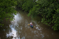 Canoeists paddle along a section of Alum Creek spanning parts of Westerville and Columbus.