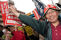 A union activist punches the air as he marches at anti APEC (Asia Pacific Economic Conference)  Demo by left-wing activist groups and trade unions in Yokohama, Japan Sunday November 14th 2010
