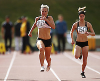 Auckland's Veronica Torr (left) competes in the women's 100m heats, alongside Wellington's Sarah Hosegood during the National athletics championships at Newtown Park, Wellington, New Zealand on Friday, 27 March 2009. Photo: Dave Lintott / lintottphoto.co.nz