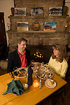 couple enjoys dining in a rustic restaurant