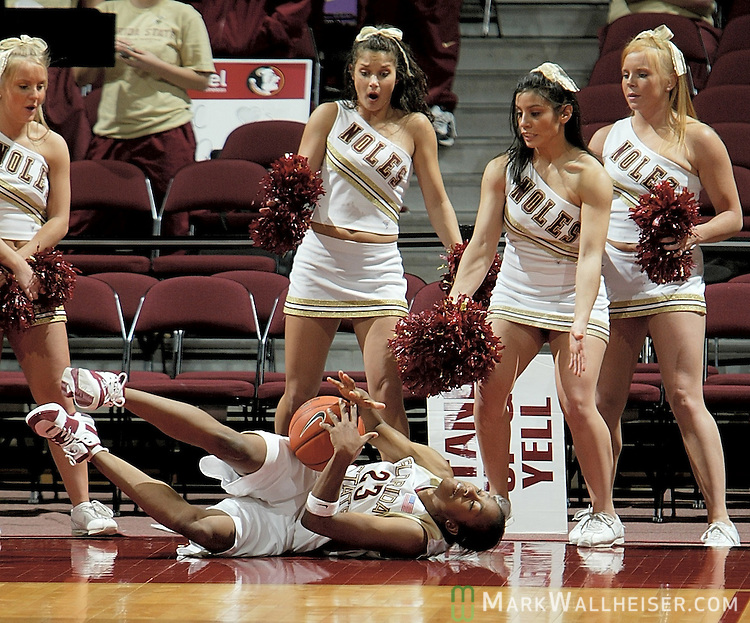 Some of the Florida State cheerleaders react to Alicia Gladden's fall after she dove for a ball headed out of bounds in the Seminole's win over 19th ranked Boston College 71-60 in their final game of the season February 26, 2006.