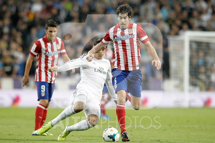 Real Madrid's Alvaro Morata (l) and Atletico de Madrid's Tiago Cardoso during La Liga match.September 28,2013. (ALTERPHOTOS/Acero)