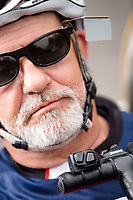 Morehead City, NC -- Buttons allow Paul to shift the bike's gears with his chin. Quadriplegic hand cyclist Paul Kelly, 62, trains for the Boston Marathon Tuesday, March 27, 2018. (Justin Cook for The Wall Street Journal)<br /> <br /> SUMMARY:<br /> <br /> Paul Kelly, hand cyclist, Beaufort, NC Training for the Boston Marathon so we would want to shoot in March to run the week before the marathon or marathon Monday, Apriln16. Life as a quadriplegic doesn&rsquo;t keep 62-year-old Paul Kelly on the sidelines. After breaking his neck in a swimming accident in 1978, Kelly was determined to find fitness activities to maintain an active lifestyle. He discovered handcycles while watching his niece compete in the 2006 Marine Corps Marathon and was inspired to start his own marathon career to stay fit. Paul has competed in over 100 half and full marathons. On April 16, he will celebrate his 40th year of living as a quadriplegic by taking on one of the most coveted races for a marathoner -- the Boston Marathon. Kelly is among the 60 handcyclists competing in the 2018 Boston Marathon with a qualifying time of 1:26:37. Most of Paul&rsquo;s distance training takes place at Bogue Banks, which includes Atlantic Beach, Salter Path, and Emerald Isle, N.C. It&rsquo;s Nicholas Sparks worthy scenery with its marshes, waterways, inlets and small islands. Paul is particularly fond of the approach from Atlantic Beach to Bogue Banks -- it&rsquo;s via the high-rise bridge. In cold weather, Paul has to be mindful of the environment and dress in a manner that insulates his legs while also allowing his upper body to ventilate. Paul chooses to train at times of day when the temperatures are more reasonable. He uses hand warmers in his gloves, on the inside the grips on his handcycle and in the legs of his trousers.