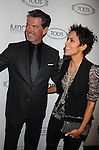 BEVERLY HILLS, CA. - April 15: Pierce Brosnan and Halle Berry arrive at the Diego Della Valle Cocktail Celebration Honoring Tod's Beverly Hills Boutique on April 15, 2010 in Beverly Hills, California.