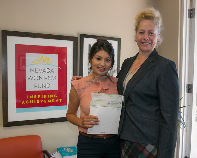 Noemi Gomez Martinez, left, and Board Member Tricia Gallenbeck during the Nevada Women's Fund Scholarship distribution, June 20, 2019.