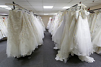 COPY BY TOM BEDFORD<br /> Pictured: Some of the wedding dresses on display at the John Pye Auctions warehouse in Pyle, south Wales, UK.<br /> Re: A bride cried tears of joy after her missing wedding dress was found among a pile of 20,000 gowns in a warehouse.<br /> Meg Stamp, 27, paid &pound;1,300 for the beautiful ivory lace dress but it  was seized by liquidators after a bridal company went bust.<br /> It was boxed up along with 20,000 others and due to be sold for a knock-down price at auction.<br /> But determined Meg banged on the auctioneer door saying: &ldquo;I want my dress back&rdquo;.<br /> Staff at John Pye auctioneers in Port Talbot spent three hours sifting through boxes until they finally found Meg&rsquo;s dream dress.COPY BY TOM BEDFORD<br /> Pictured: at the John Pye Auctions warehouse in Pyle, south Wales, UK.<br /> Re: A bride cried tears of joy after her missing wedding dress was found among a pile of 20,000 gowns in a warehouse.<br /> Meg Stamp, 27, paid &pound;1,300 for the beautiful ivory lace dress but it  was seized by liquidators after a bridal company went bust.<br /> It was boxed up along with 20,000 others and due to be sold for a knock-down price at auction.<br /> But determined Meg banged on the auctioneer door saying: &ldquo;I want my dress back&rdquo;.<br /> Staff at John Pye auctioneers in Port Talbot spent three hours sifting through boxes until they finally found Meg&rsquo;s dream dress.