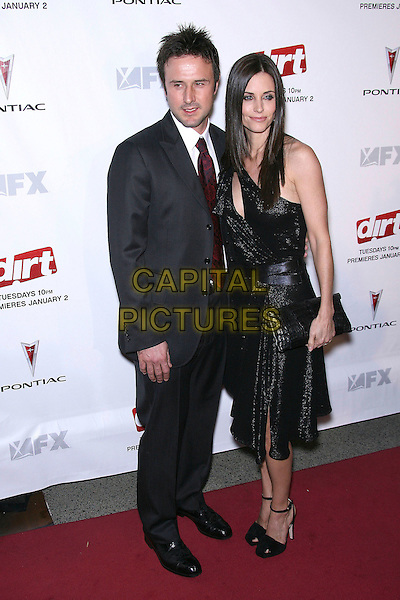 "DAVID ARQUETTE & COURTENEY COX ARQUETTE.FX Hosts the premiere screening of ""Dirt"" - Arrivals held at Paramount Theatre, Los Angeles, California, USA,.9th December 2006..full length black dress vintage slash slit one shoulder suit married couple husband wife courtney.CAP/ADM/ZL.©Zach Lipp/Admedia/Capital Pictures"