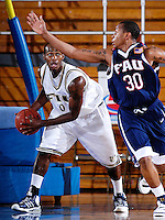 Florida International University Golden Panthers versus the Florida Atlantic University Owls at Pharmed Arena, Miami, Florida on Thursday, December 28, 2006.  FAU's DeAndre Rice sunk a three-point shot with 5.9 seconds left in the game to lift the Owls to a 68-66 win over the Golden Panthers...Junior guard Chris Fuller (0)<br />