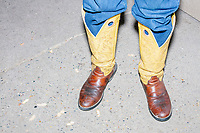 A man wears yellow cowboy boots in the Horse Barn at the Iowa State Fair in Des, Moines, Iowa, on Sun., Aug. 11, 2019.