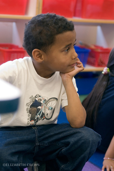 Oakland CA 1st grade boy day dreaming in class