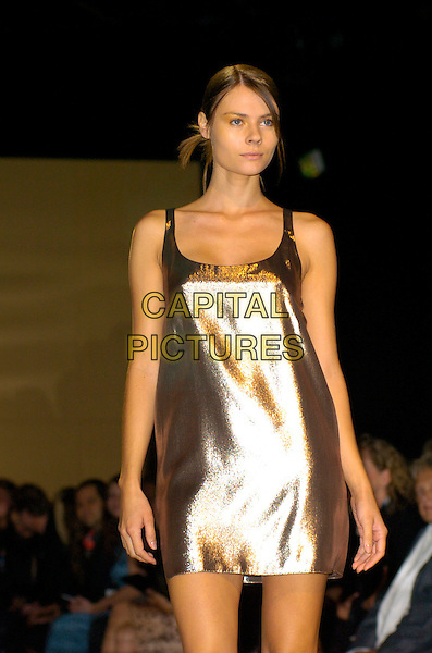 MODEL.On the Catwalk during the Jasper Conran Spring /Summer 2008 Fashion Show, BFC Tent, London, England, September 17th 2007..half length LFW modelling runway silver metallic shiny mini dress.CAP/CAN.©Can Nguyen/Capital Pictures