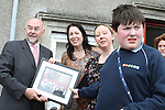 Student Luke Owens makes a presentation to Ruairi Quinn TD Minister for Education and Skills as he officially opens ABACAS School on Fair Street. Pictured also with his mother Lucy and teacher Juliette Quinlan...(Photo credit should read Jenny Matthews www.newsfile.ie)....This Picture has been sent you under the conditions enclosed by:.Newsfile Ltd..The Studio,.Millmount Abbey,.Drogheda,.Co Meath..Ireland..Tel: +353(0)41-9871240.Fax: +353(0)41-9871260.GSM: +353(0)86-2500958.email: pictures@newsfile.ie.www.newsfile.ie.