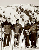 USA, Utah, portrait of old friends holding skis and ski poles, 80+ ski club, Alta Ski Resort (B&W)