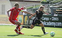 Abby Wambach (20) and Rachel Buehler. Washington Freedom defeated FC Gold Pride 4-3 at Buck Shaw Stadium in Santa Clara, California on April 26, 2009.