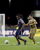 New England Revolution midfielder Shalrie Joseph (21) dribbles as Philadelphia Union midfielder Stefani Miglioranzi (6) pressures. The Philadelphia Union defeated New England Revolution, 2-1, at Gillette Stadium on August 28, 2010.