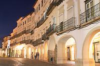 Street view. Cobble stones. Houses and arches on Praca do Giraldo. Evora, Alentejo, Portugal