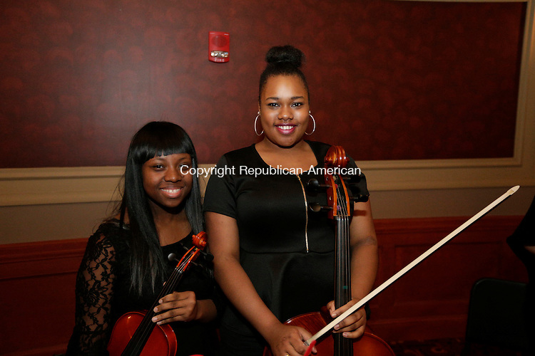 Waterbury, CT- 09 April 2016-040916CM14- Social moments, from left members of the Waterbury Arts Magnet School chamber orchestra Kengina Power and Azure Grady are photographed during the Brass City Ballet's 30th anniversary gala on April 9 at the Palace Theater in Waterbury .   Christopher Massa Republican-American