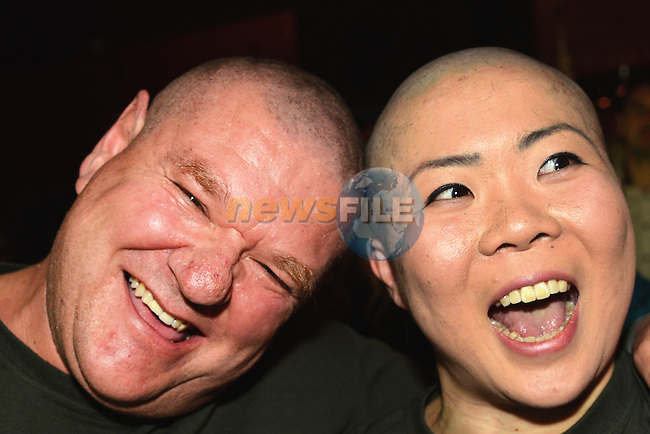 Erin O'Connor and Carel Mienie after they had their heads shaved to raise funds for the Gary Kelly Cancer Support Centre and the Bone Marrow for Leukaemia Trust. Photo: Andy Spearman. www.newsfile.ie www.newsfile.ie