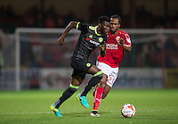 Joseph Colley of Chelsea takes on Nathan Delfouneso of Swindon Town during the The Checkatrade Trophy match between Swindon Town and Chelsea U23 at the County Ground, Swindon, England on 13 September 2016. Photo by Andy Rowland.