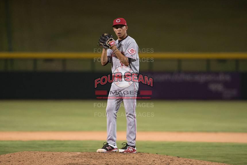 AZL Reds relief pitcher Alberto Gonzalez (33) prepares to deliver a pitch during an Arizona League game against the AZL Cubs 1 at Sloan Park on July 13, 2018 in Mesa, Arizona. The AZL Cubs 1 defeated the AZL Reds 4-1. (Zachary Lucy/Four Seam Images)