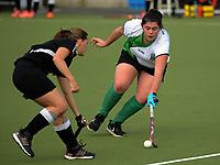 Action from the Wellington Hockey women's open grade premier two match between Karori (black) and Wainuiomata at National Hockey Stadium in Wellington, New Zealand on Sunday, 23 July 2017. Photo: Dave Lintott / lintottphoto.co.nz