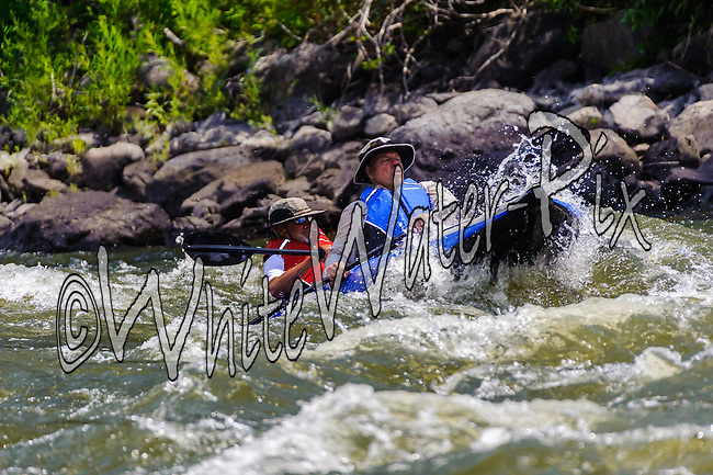 Private Rafters, Kayakers, Canoers, Paddle Boarders & Tubers crashing Cable Rapid while running the Upper Colorado River from Rancho Del Rio to State Bridge on August 9, 2014.
