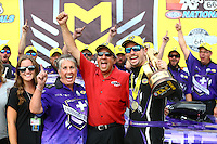 Jul 10, 2016; Joliet, IL, USA; NHRA funny car driver Jack Beckman (right) celebrates with team owner Don Schumacher (center) and sponsor Terry Chandler after winning the Route 66 Nationals at Route 66 Raceway. Mandatory Credit: Mark J. Rebilas-USA TODAY Sports