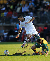 Clint Dempsey of USA and Luke Wilkshire of Australia...Football - International Friendly - USA v Australia - Ruimsig Stadium
