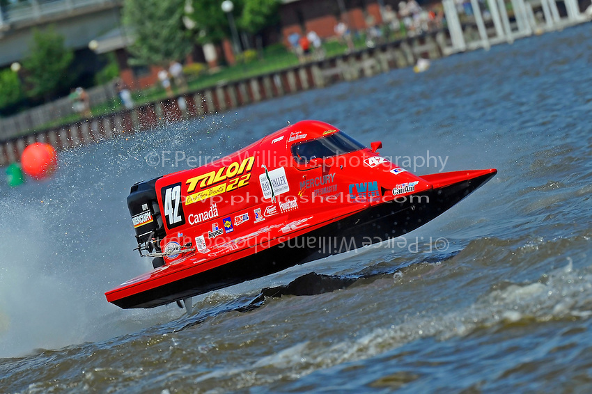 Shaun Torrente's Grand Prix/Mercury flies over the Saginaw River. F1/Formula 1 class.Bay City River Roar, Bay City,Michigan USA.26-2821 June, 2009..©F. Peirce Williams 2009 USA.F.Peirce Williams.photography.ref: RAW (.NEF) File Available