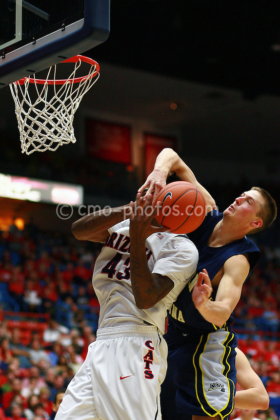 Nov 30, 2008; Tucson, AZ, USA; Arizona Wildcats forward Jordan Hill (43) is fouled by Northern Arizona Lumberjacks forward Shane Johannsen (40) in the second half of a game at the McKale Center.  Arizona won the game 74-57.