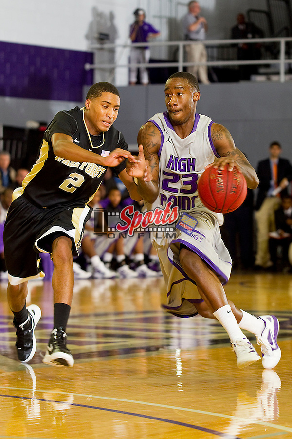 Jairus Simms #23 of the High Point Panthers drives past Anthony Fields #2 of the Wake Forest Demon Deacons at Millis Athletic Center on December 7, 2011 in High Point, North Carolina.  The Demon Deacons defeated the Panthers 87-83.   (Brian Westerholt / Sports On Film)