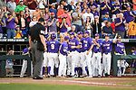 OMAHA, NE - JUNE 26: Zach Watson (9) of Louisiana State University is greeted by teammates after scoring a run against the University of Florida during the Division I Men's Baseball Championship held at TD Ameritrade Park on June 26, 2017 in Omaha, Nebraska. The University of Florida defeated Louisiana State University 4-3 in game one of the best of three series. (Photo by Jamie Schwaberow/NCAA Photos via Getty Images)