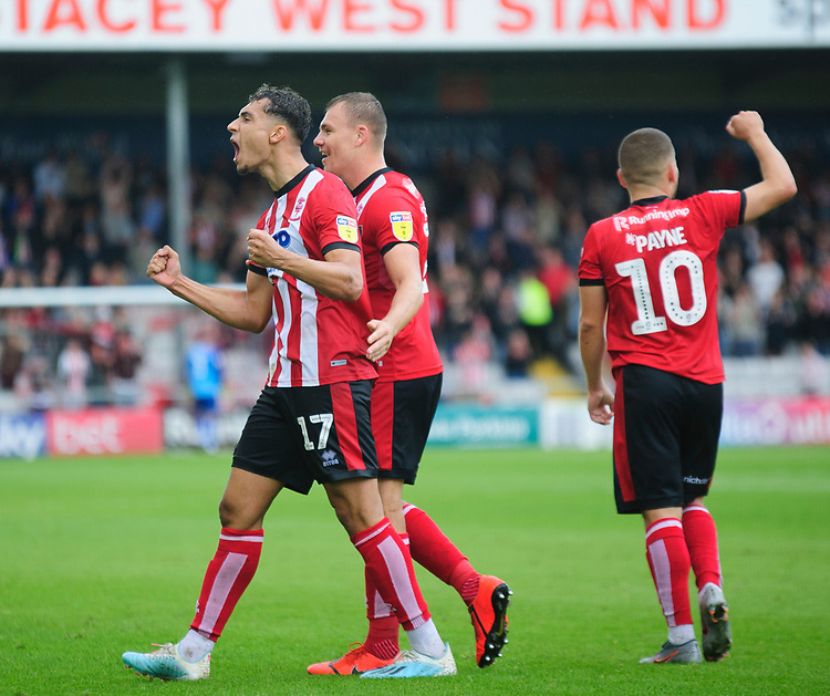 Lincoln City's Tyler Walker, left, celebrates scoring his side's second goal with team-mate ,li26`<br /> <br /> Photographer Andrew Vaughan/CameraSport<br /> <br /> The EFL Sky Bet League One - Lincoln City v Fleetwood Town - Saturday 31st August 2019 - Sincil Bank - Lincoln<br /> <br /> World Copyright © 2019 CameraSport. All rights reserved. 43 Linden Ave. Countesthorpe. Leicester. England. LE8 5PG - Tel: +44 (0) 116 277 4147 - admin@camerasport.com - www.camerasport.com