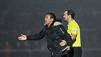 The fourth Official Simon Barrow holds back Ricardo Moniz Manager of Notts County during the Sky Bet League 2 match between Wycombe Wanderers and Notts County at Adams Park, High Wycombe, England on 15 December 2015. Photo by Andy Rowland.
