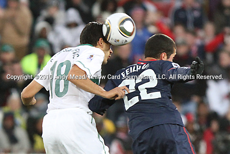 18 JUN 2010:  Aleksandar Radosavljevic (SVN)(18) beats Benny Feilhaber (USA)(22) to a head ball.  The Slovenia National Team tied the United States National Team 2-2 at Ellis Park Stadium in Johannesburg, South Africa in a 2010 FIFA World Cup Group C match.
