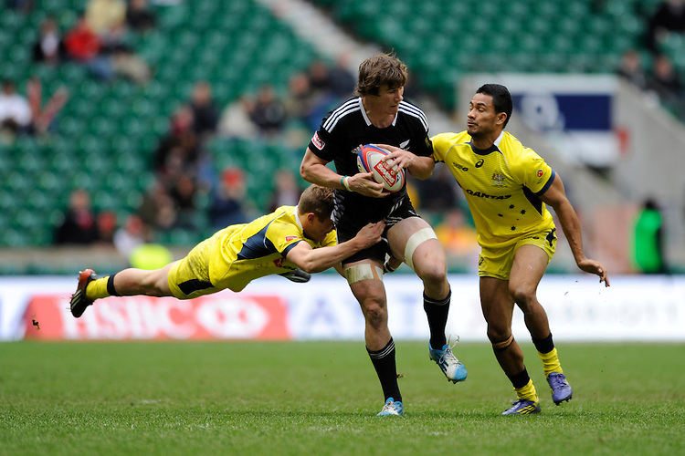 Sam Dickson of New Zealand is tackled by Tom Lucas and Afa Pakalani of Australia during Day Two of the iRB Marriott London Sevens at Twickenham on Sunday 11th May 2014 (Photo by Rob Munro)