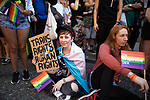© Joel Goodman - 07973 332324 - all rights reserved . 24/08/2019. Manchester, UK. Trans Rights are Human Rights banner held by a member of the watching crowd . The 2019 Manchester Gay Pride parade through the city centre , with a Space and Science Fiction theme . Manchester's Gay Pride festival , which is the largest of its type in Europe , celebrates LGBTQ+ life . Photo credit: Joel Goodman/LNP