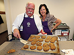 Ben and Elana Graham pose with some of the estimated 1,400 cookies they baked on the annual Day of a Thousand Cookies at the Legislative Building, in Carson City, Nev., on Monday, May 20, 2013. .Photo by Cathleen Allison