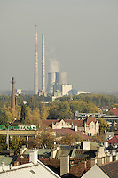 Poland, Krakow, View over rooftops to power plant