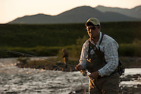 150620-JRE-7981E-0294 Joshua Quong, a teacher and quail hunting guide from Mississippi, fishes an interior Alaska stream for Arctic Grayling.