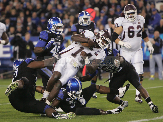 Mississippi State senior quarterback Chris Relf gets tackled by UK defenders during the first half of UK's blackout home game against Mississippi State at Commonwealth Stadium in Lexington, Ky., on Saturday, Oct. 29, 2011. Photo by Tessa Lighty | Staff