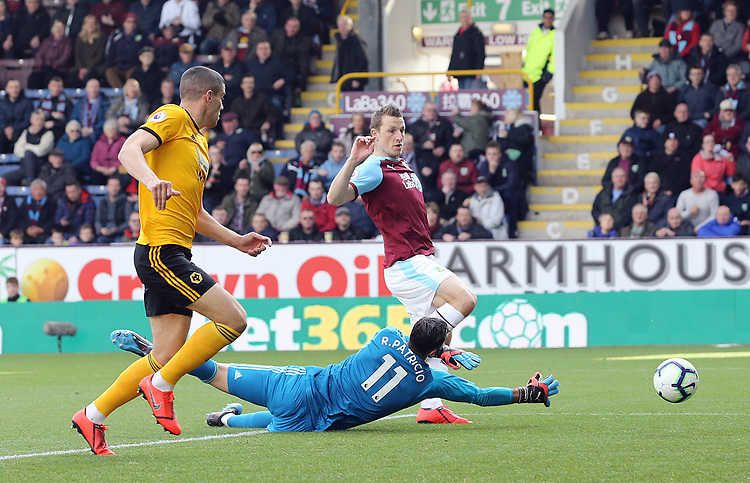 Burnley's Chris Wood scores the opening goal past Wolverhampton Wanderers' Rui Patricio<br /> <br /> Photographer Rich Linley/CameraSport<br /> <br /> The Premier League - Burnley v Wolverhampton Wanderers - Saturday 30th March 2019 - Turf Moor - Burnley<br /> <br /> World Copyright © 2019 CameraSport. All rights reserved. 43 Linden Ave. Countesthorpe. Leicester. England. LE8 5PG - Tel: +44 (0) 116 277 4147 - admin@camerasport.com - www.camerasport.com