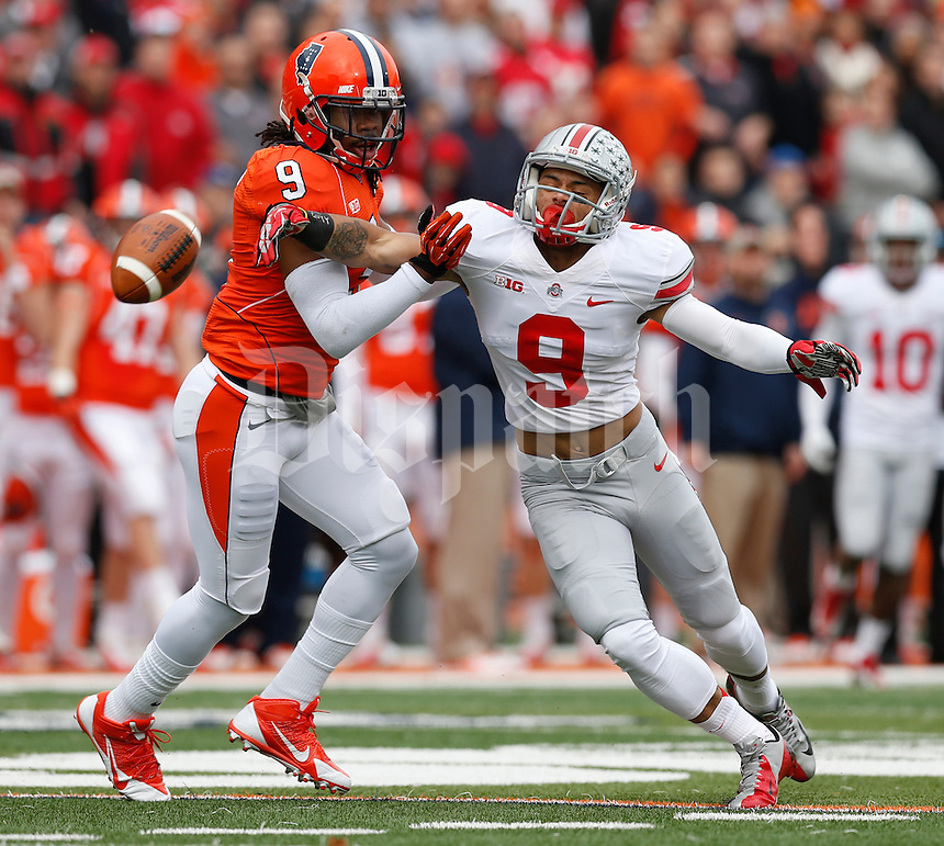 Ohio State Buckeyes wide receiver Devin Smith (9) reaches for a pass while defended by Illinois Fighting Illini defensive back Earnest Thomas III (9) during Saturday's NCAA Division I football game at Memorial Stadium in Champaign, Il., on November 16, 2013. Ohio State won the game 60-35. (Barbara J. Perenic/The Columbus Dispatch)