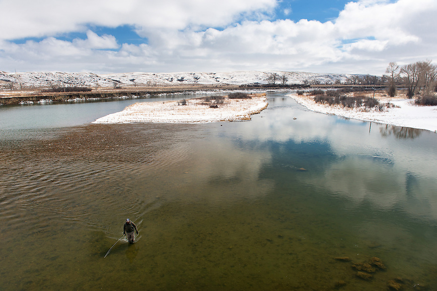 An angler wades below Pugsley Bridge on the Marias River in northern Montana.