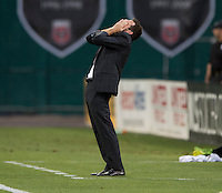 D.C. United head coach Ben Olsen reacts to a missed chance during a Major League Soccer match at RFK Stadium in Washington, DC. D.C. United lost to the Vancouver Whitecaps, 1-0.